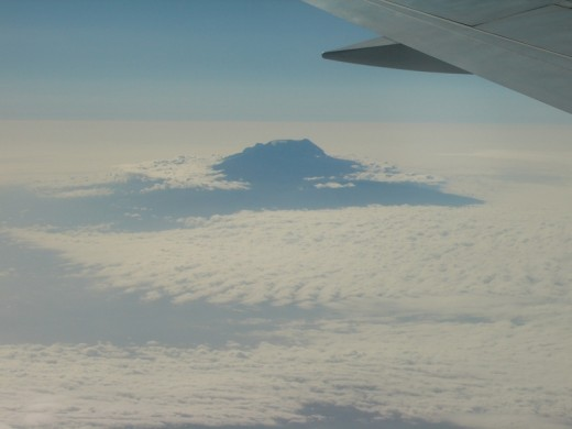 Mount Kilimanjaro peers through the clouds
